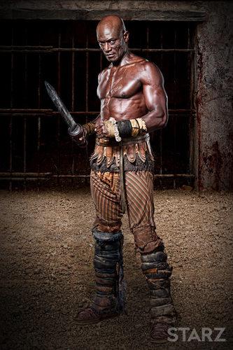 Oenomaus portrayed by Peter Mensah